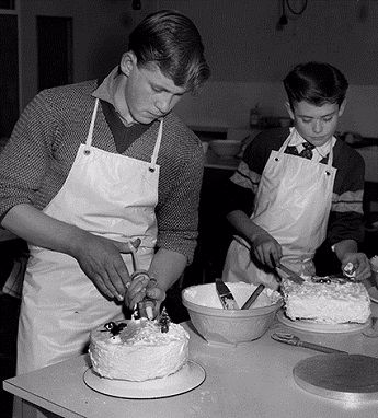 Two students at Barnwell School making Christmas cakes in cookery class
