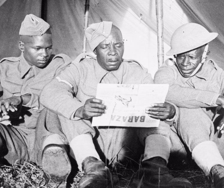 Men reading a paper